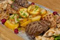 Rustic grilled beef steak with potatoes Royalty Free Stock Photos