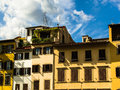 Rustic italian apartments historical in florence on a summer day Royalty Free Stock Photo