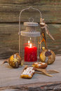 Rustic lantern for christmas with candlelights and wood wooden background Royalty Free Stock Photography