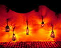 Rustic lit hanging lanterns Royalty Free Stock Image