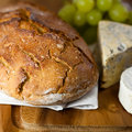 Rustic loaf of bread  and cheese Royalty Free Stock Photo