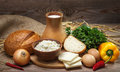 Rustic natural organic foods farmers balanced diet cooking culinary food concept dairy products bread cheese cottage cheese eggs Stock Images