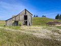 Rustic old barn in field an run down a near potlach idaho Stock Photo