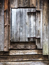 Rustic old barn a side view of an with a small wooden door Stock Photo