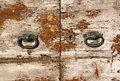Rustic old door with knobs olf shabby handles and lock Royalty Free Stock Photo