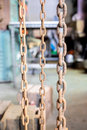 Rustic old grunge chains link in old factory