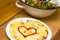 Rustic omelette egg omelet with potatoes bacon and bowl of salad Royalty Free Stock Photo