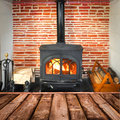 Rustic planks, wood burning stove Royalty Free Stock Photo
