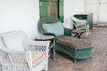 Rustic porch seating well worn invites you to the Stock Image