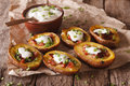 Rustic potato skins with cheese, bacon and sour cream close-up Royalty Free Stock Photo