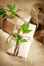 Rustic present boxes natural style handcrafted gift with twine on burlap Royalty Free Stock Photography