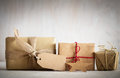 Rustic retro gifts, present boxes with tag. Christmas time, eco paper wrap. Royalty Free Stock Photo