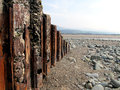 Rustic sea defences wales deffences on the beach at llandanwg Royalty Free Stock Photos
