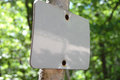 Rustic sign photograph nailed on tree Royalty Free Stock Photos