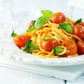 Rustic spaghetti with broccoli and tomatoes Royalty Free Stock Photo