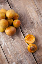Rustic still life with apricots fresh ripe antique plates forks and napkins on wooden table vintage food Royalty Free Stock Image