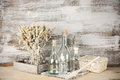Rustic still life glass bottles and dry flowers on wooden background Royalty Free Stock Images