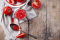 Rustic still life with tomatoes fresh ripe tomato juice a spoon and a rough cloth on a wooden table vintage food Stock Photography