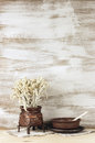 Rustic still life wicker and ceramic utensil on wooden background Royalty Free Stock Image