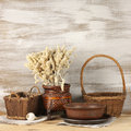 Rustic still life wicker and ceramic utensil on wooden background Royalty Free Stock Photos