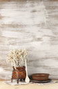 Rustic still life wicker and ceramic utensil on wooden background Stock Image