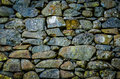 Rustic stone wall texture background of an ancient Stock Photography