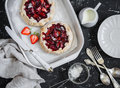 Rustic strawberry pie on a dark  background. Delicious summer dessert Royalty Free Stock Photo