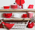 A rustic style. Ceramic tableware and kitchenware in red on the Royalty Free Stock Photo