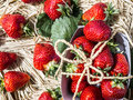 Rustic style strawberries fresh bio on a thatch stile Royalty Free Stock Photography