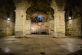 Rustic underground room with pillars Royalty Free Stock Photos