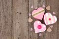 Rustic Valentines Day heart shaped gift boxes over wood Royalty Free Stock Photo