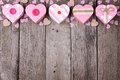 Rustic Valentines Day top border with pink heart-shaped gift boxes Royalty Free Stock Photo