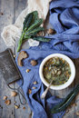 Rustic vegetables soup with legumes and lacinato kale on table with blue cloth bread walnuts Stock Photos