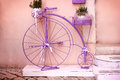 Rustic - vintage, outmoded purple bicycle Royalty Free Stock Photo