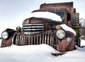 Rustic vintage truck in montana located sits dusted snow Stock Photos