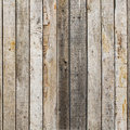 Rustic weathered barn wood background with knots and nail holes Royalty Free Stock Photo