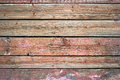 Rustic weathered barn wood background painted in red color Royalty Free Stock Photo