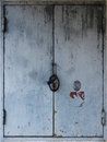 Rustic weathered metal door shutters Royalty Free Stock Photo