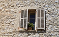 Rustic window with old wood shutters in stone rural house prove french provence france Stock Photography