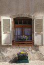 Rustic window with old wood shutters in stone rural house switz and flower pots switzerland Stock Photography