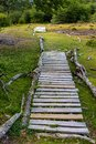 Rustic wood path through marshy area, leading to wooded trail, in Cerro Alarken Nature Reserve, Ushuaia, Argentina Royalty Free Stock Photo
