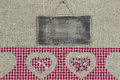 Rustic wood sign with red plaid border with heart cutouts on burlap background Stock Photography