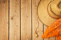 Rustic wooden background with cowboy hat and bandanna view from above Royalty Free Stock Photography