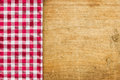 Rustic wooden background with a red checkered tablecloth table cloth Royalty Free Stock Photography