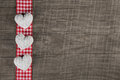 Rustic wooden background with red white checkered frame and thre Royalty Free Stock Photo