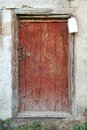 Rustic wooden barn door with white milk can Royalty Free Stock Photo