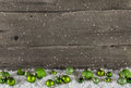 Rustic wooden country background with green christmas balls. Royalty Free Stock Photo