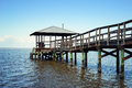 Rustic wooden fishing and swimming pier vintage off the beaten path Stock Image