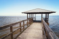 Rustic wooden fishing and swimming pier vintage off the beaten path Royalty Free Stock Image