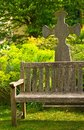 Rustical bench in blossom graveyard Stock Photography